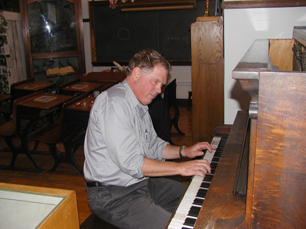 Russ Kaspar tinkles the keys for an hour before the program starts